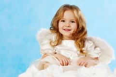 happy little girl with smile wearing angel dress - stock photo
