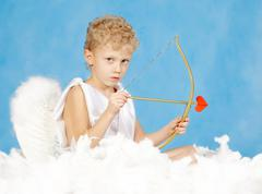 portrait of little male cupid with bow - stock photo