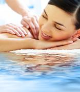 Smiling female during luxurious procedure of massage Stock Photos