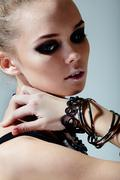 gorgeous model with stylish bracelets on wrists - stock photo