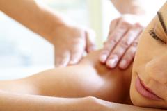 part of face of calm female during luxurious procedure of massage - stock photo