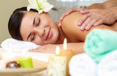 Portrait of young female enjoying the procedure of massage Stock Photos