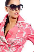 gorgeous woman in fashionable coat and sunglasses looking aside - stock photo