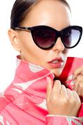 Gorgeous woman in stylish sunglasses looking at camera Stock Photos