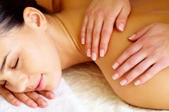 Close-up of pleased female during luxurious procedure of massage Stock Photos