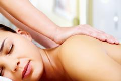 close-up of calm female taking pleasure during massage - stock photo