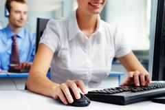 woman using computer on her workplace - stock photo