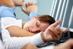 A businesswoman falling asleep on her workplace Stock Photos