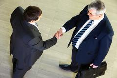 High angle view of two businessmen shaking hands Stock Photos