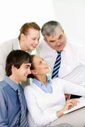 portrait of several colleagues sitting in office and working - stock photo