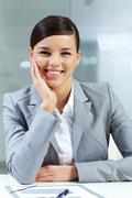 image of successful employer looking at camera in office - stock photo