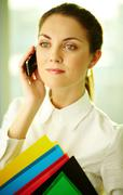 A beautiful businesswoman talking by cellular phone in office Stock Photos