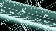 Stock Video Footage of tape measure against blueprints of industrial design