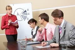 image of smart teacher looking at businessman and speaking to him in workshop - stock photo