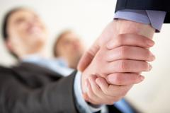 close-up of business people sharing hands - stock photo