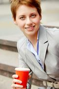 portrait of happy young business woman during break outdoor - stock photo
