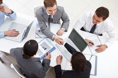 above view of business partners handshaking - stock photo