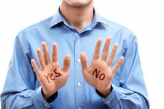 close-up of man showing his palms with choice no or yes - stock photo