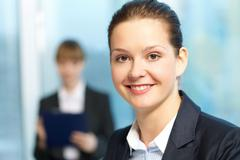 Close-up of young smiling businesswoman's face Stock Photos