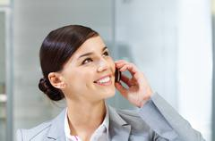image of busy businesswoman calling by mobile during her work - stock photo