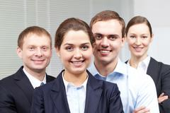 portrait of a cheerful confident business team - stock photo