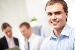portrait of a young smiling confident businessman - stock photo