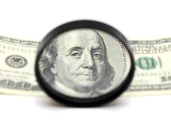 franklin through magnifying glass - stock photo