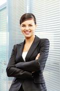 Image of formal businesswoman in suit on the background of jalousie Stock Photos