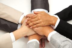 image of eight hands clutched together - stock photo