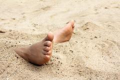 Bare foot in sand Stock Photos