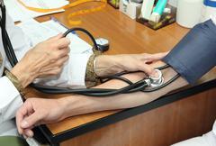 Blood pressure measurement Stock Photos