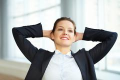 portrait of a young businesswoman relaxing - stock photo