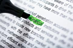 Image of picking out word of financial by green marker Stock Photos