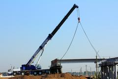 crane on the construction of overpass - stock photo
