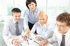 group of business partners planning work at meeting - stock photo