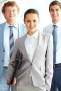 portrait of an independent businesswoman with her colleagues - stock photo