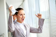 Portrait of joyful businesswoman shouting Stock Photos
