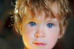 Baby with blue eyes in sunlight Stock Photos