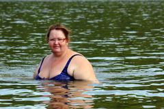 plump woman bath in river - stock photo