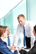 image of confident people looking at smart businessman while he explaining somet - stock photo