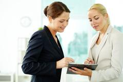 Two business women planning work Stock Photos