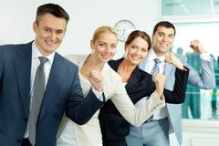 portrait of business partners showing their strength with leader in front - stock photo