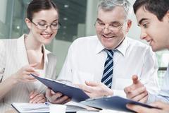 boss communicating with his subordinates - stock photo