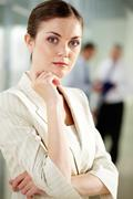 portrait of businesswoman looking at camera in working environment - stock photo