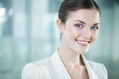 portrait of a beautiful woman looking at camera and smiling - stock photo