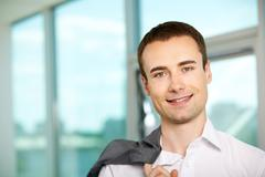 face of happy businessman looking at camera - stock photo