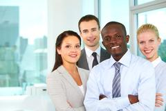 group of confident business partners looking at camera - stock photo