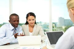 Portrait of two business partners networking at meeting Stock Photos