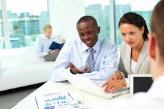 portrait of two business partners networking in office - stock photo