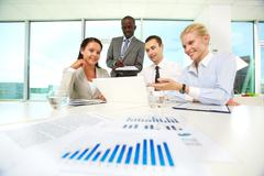 team of business people sharing their ideas while discussing new project in offi - stock photo